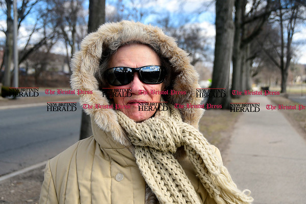 3/3/2017 Mike Orazzi | Staff A bundled up Sue Hilinski while walking along Memorial Blvd. Friday in Bristol.