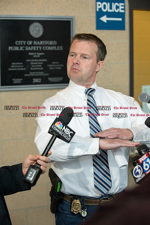 030317 Wesley Bunnell   Staff Hartford Deputy Police Chief Brian Foley motions as he explains a possible scenario regarding the rooftop where they believe CCSU student Taylor Lavoie fell to her death from the 4th story of the Angry Bull Saloon.