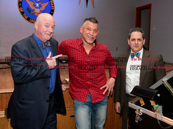 3/4/2017 Mike Orazzi | Staff Michael Palin, vice president of the NBHS PMA, with DJ. Kurt Krausse and Vincent Celentano, president of the NBHS PMA, during the New Britain High School Parent Music Associations third annual gala fundraiser held at the VFW Hall in New Britain Saturday evening. Her daughter Maeve plays the clarinet in the school's band.