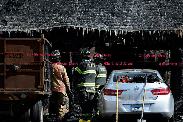 3/4/2017 Mike Orazzi | Staff The scene of a fire on Baldwin Drive in Bristol Saturday morning destroying the garage portion of the home.