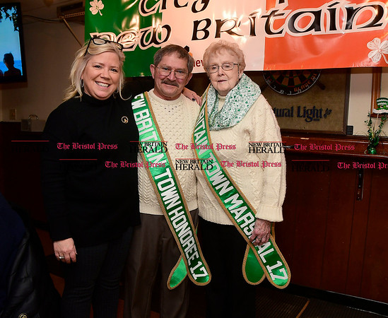 3/4/2017 Mike Orazzi | Staff Parade Committee Chairman Suzanne Parlow with Town Honoree Neil Foster and New Britain Town Marshall Joan Kelly Coyle during the St. Patrick's Day Parade Committee Fundraiser/Sash Ceremony, AOH Irish Social Club in New Britain Saturday evening.