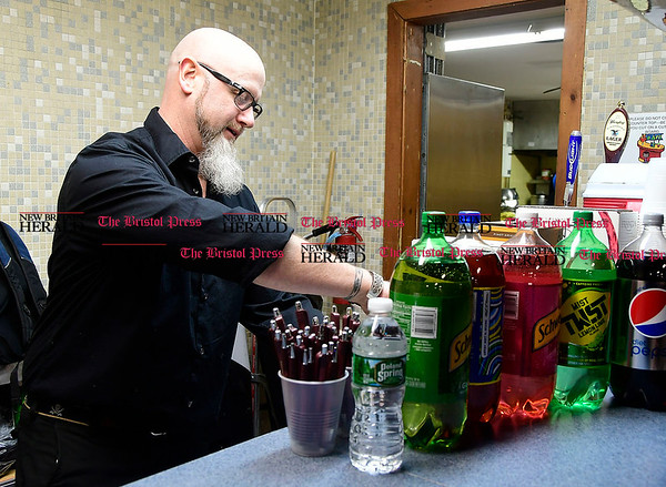 3/4/2017 Mike Orazzi   Staff Brian Lee mixes drinks during the New Britain High School Parent Music Associations third annual gala fundraiser held at the VFW Hall in New Britain Saturday evening. Her daughter Maeve plays the clarinet in the school's band.