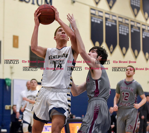 030717 Wesley Bunnell | Staff Newington basketball defeated North Haven in a first round Class L matchup. Andres Ithier Vicenty (14)