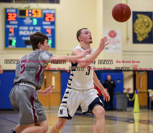 030717 Wesley Bunnell | Staff Newington basketball defeated North Haven in a first round Class L matchup. Jared Simmons (3) tracks down a ball that got away momentarily.