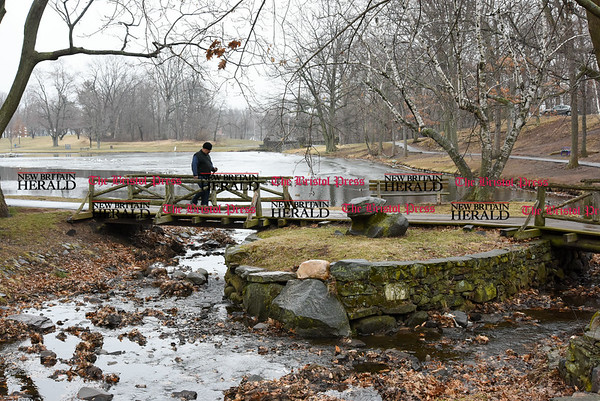 030717 Wesley Bunnell | Staff Rafael Ferreira of New Britain completes a lap around Stanley Quarter Park on Tuesday March 7. Ferreira makes a point to walk every day after work .