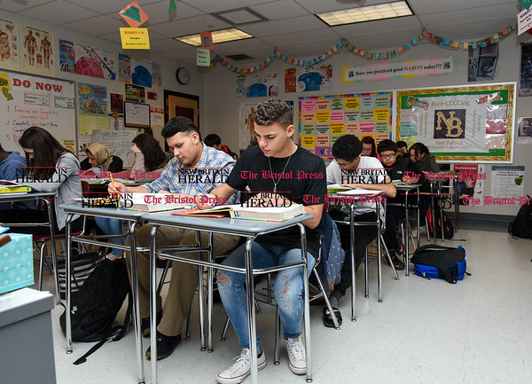 030717 Wesley Bunnell | Staff Izeiha Rodriguez, left sits with Luis Burgos in Mrs. Rogers health class in New Britain High School's Freshman Academy on March 7.