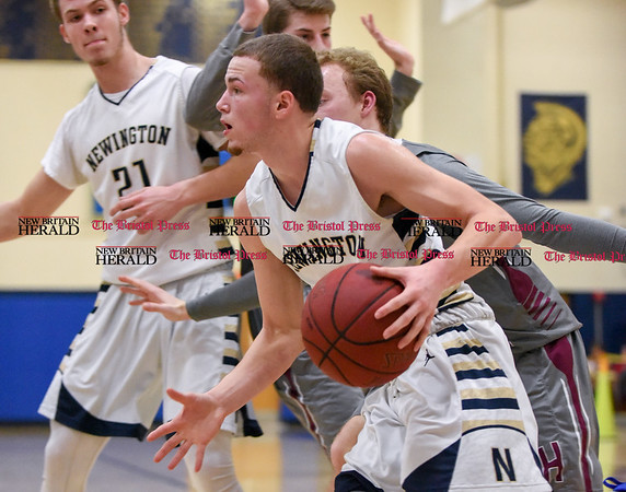 030717 Wesley Bunnell | Staff Newington basketball defeated North Haven in a first round Class L matchup. Jared Simmons (3) drives baseline towards the basket.