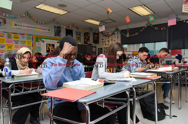 030717 Wesley Bunnell   Staff David Akinwole sits next to Morgan Giantonio in the front row in Mrs. Rogers health class in New Britain High School's Freshman Academy on Tuesday March 7.