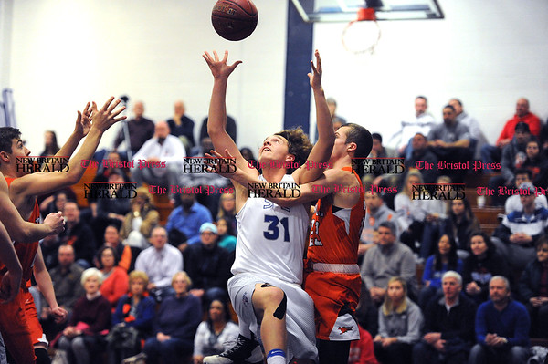 3/7/2017 Mike Orazzi   Staff St. Paul's Darek Wiecki (31) and Terryville's John Grimes (23) during the Class S First Round Boys Basketball Game in Bristol Tuesday night.