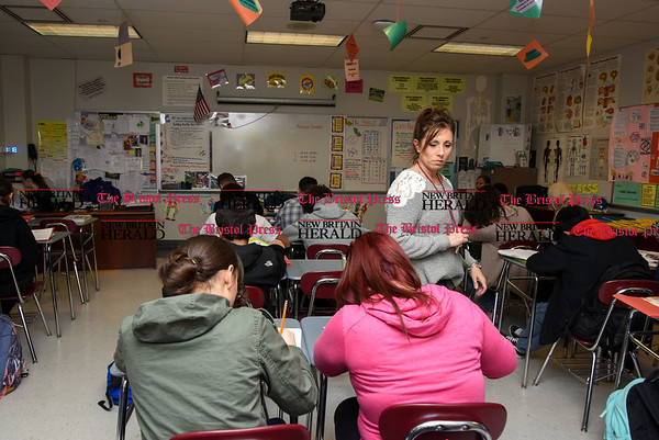 030717 Wesley Bunnell | Staff Mrs. Rogers walks desk to desk helping students on Tuesday March 7 during her health class in New Britain High School's Freshman Academy.
