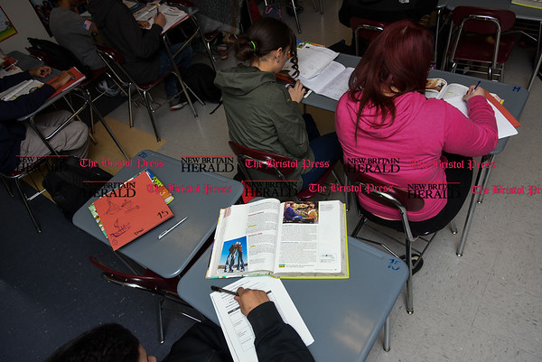 030717 Wesley Bunnell | Staff Daniel Arroyo completes a classroom assignment inside of Mrs. Rogers health class in New Britain High School's Freshman Academy on Tuesday March 7.
