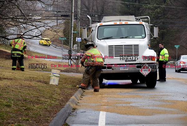 3/7/2017 Mike Orazzi   Staff Bristol firefighters spread sand along Witches Rock Road after a mechanical problem with an oil truck created a slippery road surface Tuesday afternoon.