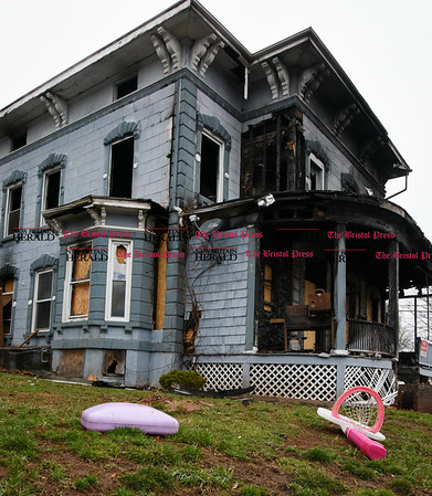 030717 Wesley Bunnell | Staff Childrens toys litter the front yard of 51 Prospect St in New Britain which was the scene of a fire on Christmas Eve 2016.