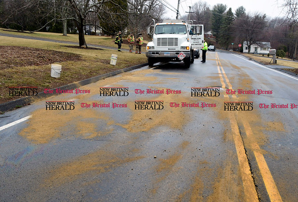 3/7/2017 Mike Orazzi | Staff Bristol firefighters spread sand along Witches Rock Road after a mechanical problem with an oil truck created a slippery road surface Tuesday afternoon.