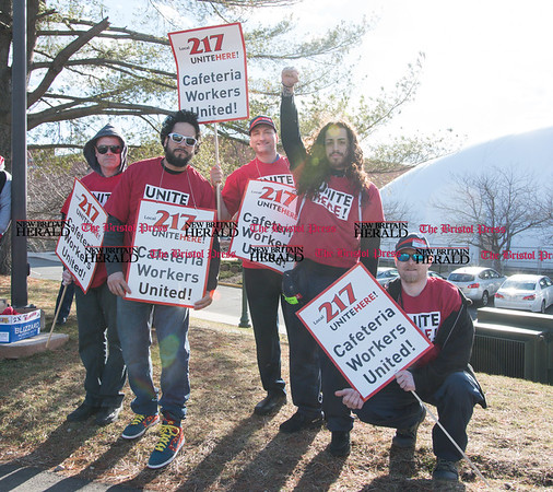 030817 Wesley Bunnell | Staff Cafeteria workers from Local 217 held a rally on the CCSU campus on Wednesday March 8 for a new contract. Kenny Caraballo, fourth from the left, helped lead the rally.