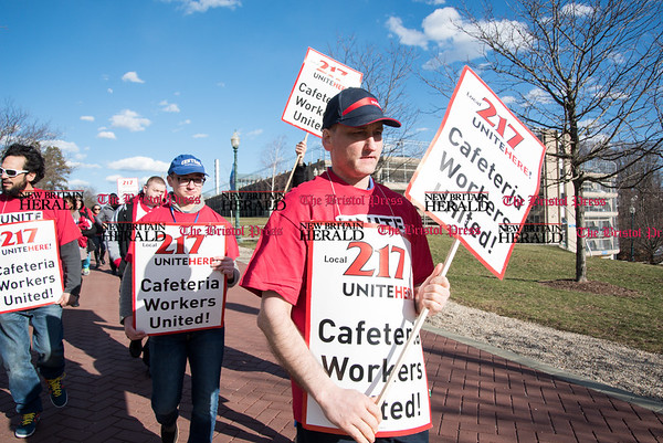030817 Wesley Bunnell | Staff Cafeteria workers from Local 217 held a rally on the CCSU campus on Wednesday March 8 for a new contract. Union members are shown marching from the Hilltop Cafeteria towards the student union.