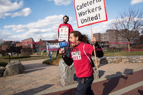 030817 Wesley Bunnell | Staff Cafeteria workers from Local 217 held a rally on the CCSU campus on Wednesday March 8 for a new contract. Kenny Caraballo helped lead the rally as they marched around campus.