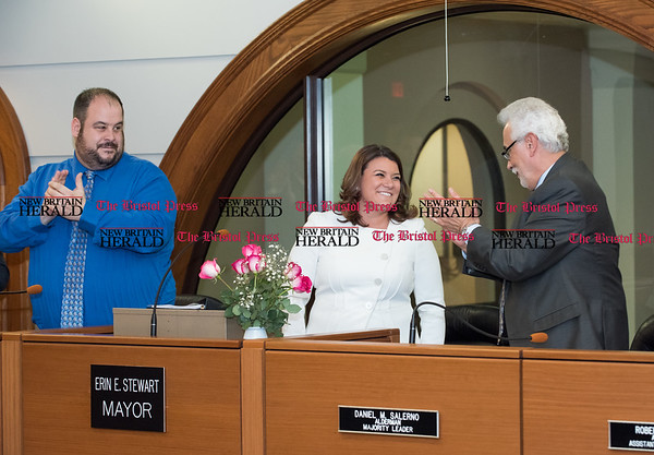 030817 Wesley Bunnell | Staff Mayor Erin Stewart gave her State of the City address on Wednesday evening March 8. Mayor Stewart is congratulated at the conclusion of her speech by city aldermen including Jaime Giantonio , left, and Daniel Salerno.