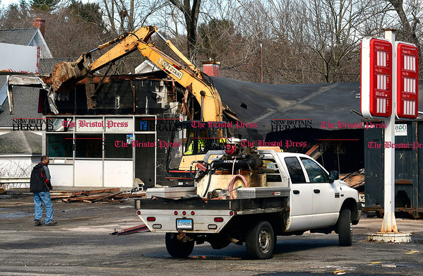 3/8/207 Mike Orazzi | Staff Demolition of the Mayfair Garage along Route 6 in Terryville Wednesday morning.