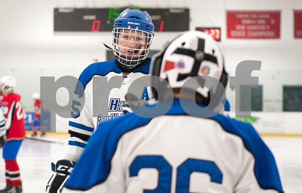 03/01/18 Wesley Bunnell | Staff Hall-Southington defeated EO Smith-Tolland 4-3 in the CCC South semi-final game on Thursday at Veterans Memorial Rink in West Hartford. Andrew Mitchell (15) skates over to Zach Monti (36) before the start of the 2nd period.