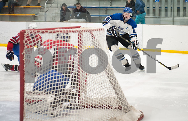 03/01/18 Wesley Bunnell | Staff Hall-Southington defeated EO Smith-Tolland 4-3 in the CCC South semi-final game on Thursday at Veterans Memorial Rink in West Hartford. Andrew Mitchell (15).