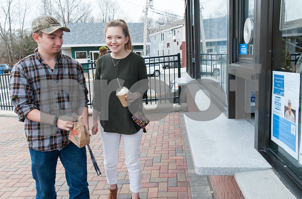 03/01/18 Wesley Bunnell | Staff Berlin High School students Richard and Erin Scalora leave with their orders at Dairy Queen in Kensington on its first day of business for 2018 on Thursday.