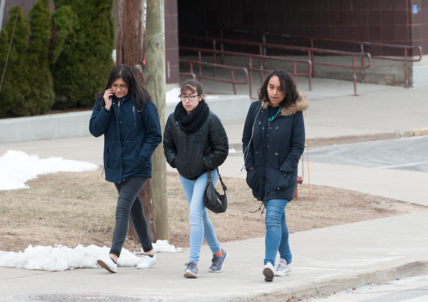 03/21/18 Wesley Bunnell | Staff New Britain High School students walk down the sidewalk together on early dismissal due to the nor'easter expected later in the day on Wednesday.