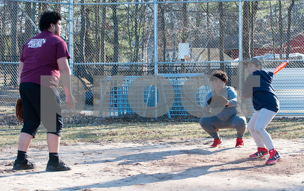 03/26/18 Wesley Bunnell | Staff Austin Collins, age 17, tosses soft toss to his brother Kason, age 11, as brother Noah , age 14, catches before the start of Kason's team practice for Forrestville Little League on Monday evening.