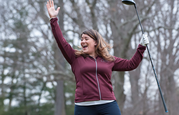 03/29/18 Wesley Bunnell | Staff Mayor Erin Stewart celebrates after hitting the ball down the middle of the fairway on the opening tee shot on the first tee on opening day at Stanley Golf Course on Thursday morning.