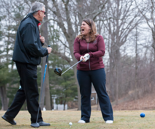 03/29/18 Wesley Bunnell | Staff Mayor Erin Stewart jokes around with Chairman of the Parks and Recreation Commission Patrick Dorsey before Stewart hit the ceremonial first balls on the first tee on opening day at Stanley Golf Course on Thursday morning.