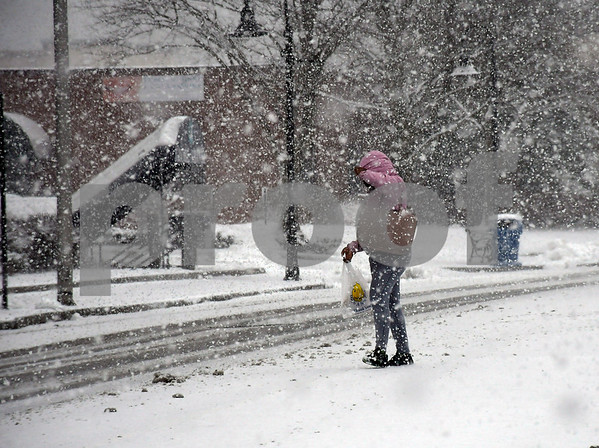 3/13/2018 Mike Orazzi | Staff A woman crosses North Main Street during Tuesday's storm in Bristol.