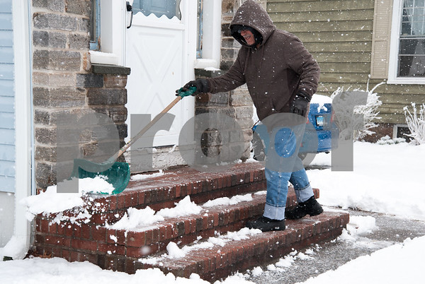 03/13/18 Wesley Bunnell | Staff Guisseppe Didomenico of Hillcrest Ave shovels his front steps during the latest snowstorm on Tuesday.