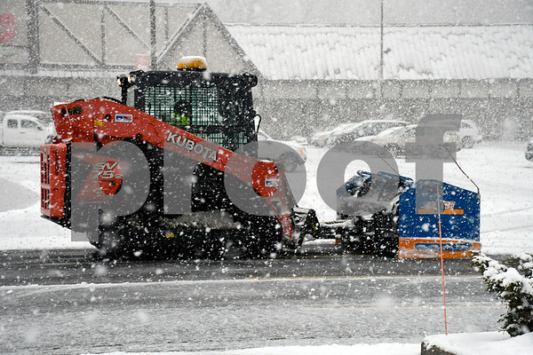 3/13/2018 Mike Orazzi | Staff Snow removal in the Price Chopper parking lot during Tuesday's storm in Bristol.