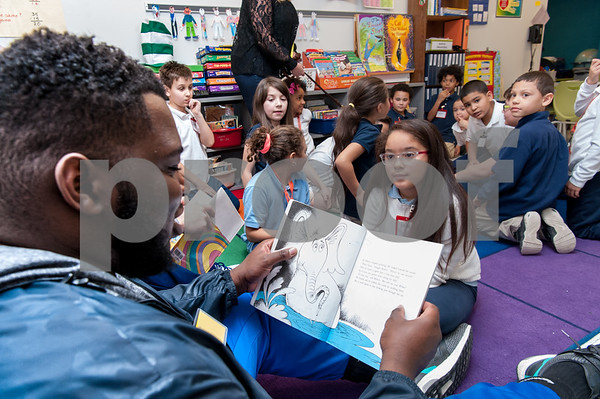 03/02/18 Wesley Bunnell | Staff CCSU student and football player Cheickna Douceur reads to Genesis Lopez in Ms. Libby's third grade class on Dr. Seuss Day aka Read Across America Day at Gaffney Elementary School on Friday.
