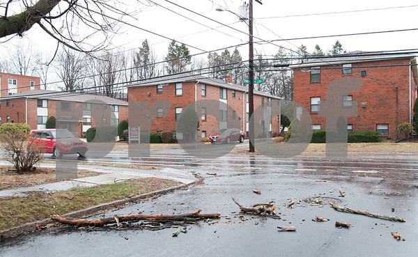 03/02/18 Wesley Bunnell | Staff Many streets featured smaller limbs down forcing drivers to weave around them while making their way through heavy rain and wind in New Britain on Friday. A limb is down at the intersection of Stewart and Allen St.