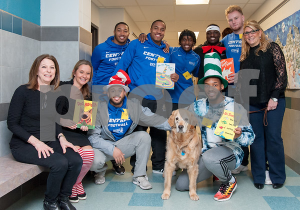 03/02/18 Wesley Bunnell | Staff CCSU football players were part of a contingent from the school who read to students at Gaffney Elementary School on Friday as part of Dr. Seuss Day aka Read Across America Day. Reading teacher Annette Levine, L, Dorothy Dziedzic, therapy dog Cooper and Principal Anita Fazio, R, stand with several players at the end of the day.