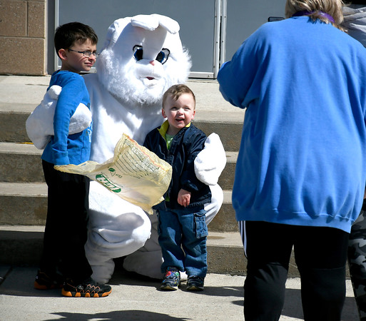 3/24/2018 Mike Orazzi | Staff Brothers Daniel and Ethan Ruedemann,7 and 3, pose with the Eastern Bunny while at the annual Terryville Lions Club Easter Egg Hunt held at Terryville High School Saturday.