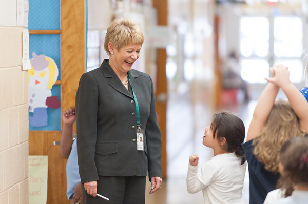 03/27/18 Wesley Bunnell | Staff Smalley Academy Principal smiles as she stops to chat with students from Mrs. Poff's first grade class after the class finished their walk through the 2nd Annual Smalley Science Fair on Tuesday morning featuring science exhibits by all grades.