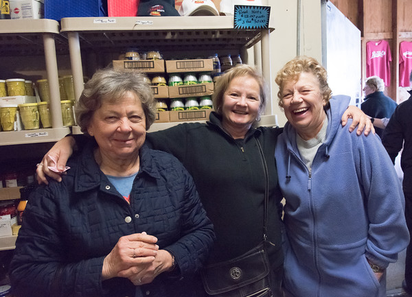 03/27/18 Wesley Bunnell | Staff Newly made friends Anna, L, Tammy and Barbara laugh and pose for a photo as they wait in line at Martin Rosol's on Tuesday afternoon in order to buy their easter kielbasa.