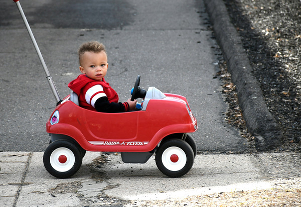 3/28/2018 Mike Orazzi | Staff Tyshawn George Teague,1, while out with his mother Elizabeth Melendez on Jacobs Street in Bristol Wednesday.