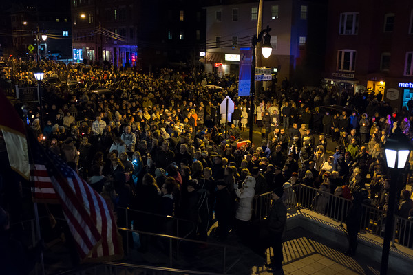 03/30/18 Wesley Bunnell   Staff Sacred Heart Church held a Stations of the Cross on Friday night featuring a procession up Broad St looping back around to finish at the church. The crowd gathers back in front of the church at the end of the procession.