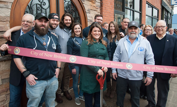 03/30/18 Wesley Bunnell | Staff 5 Churches Brewing held their ribbon cutting with city officials on Friday at noon to a crowd of customers lined down the sidewalk. From L Economic Development Director Bill Carroll, co-owner Andrew Lemnotis, co-owner Mike Barillaro, brewer Austin Japs, co-owner Christina Caccioppoli co-owner Phil Lemnotis, Becca Lemnotis co-owner Andrew Sklavouris Alderman Don Naples with Mayor Erin Stewart holding the scissors prior to the ribbon cutting with co-owner Peter Lemnotis, to her R.