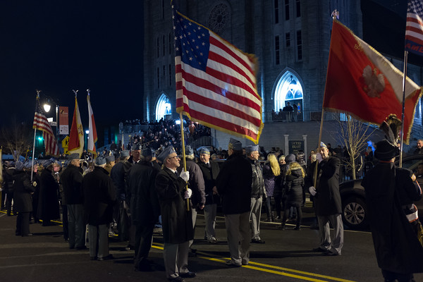 03/30/18 Wesley Bunnell   Staff Sacred Heart Church held a Stations of the Cross on Friday night featuring a procession up Broad St looping back around to finish at the church. Members of Haller Post 111 prepare to lead the procession.