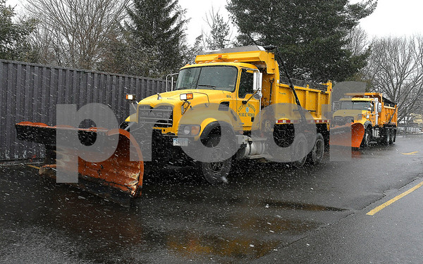 3/7/2018 Mike Orazzi | Staff A couple of Bristol city plow drivers wait for Wednesday's storm to start while at Bristol Central High School.