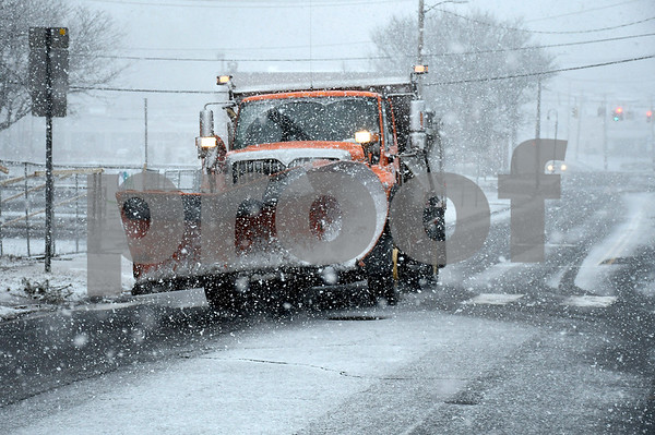 3/7/2018 Mike Orazzi | Staff A state of Connecticut snowplow on Route 6 in Bristol during Wednesday's storm.