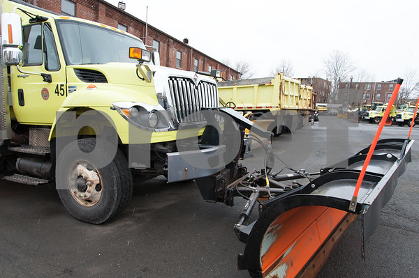 03/07/18 Wesley Bunnell | Staff A snow plow at the ready along with other city trucks in anticipation of a winter storm sit at the public works yard in New Britain on Wednesday morning.