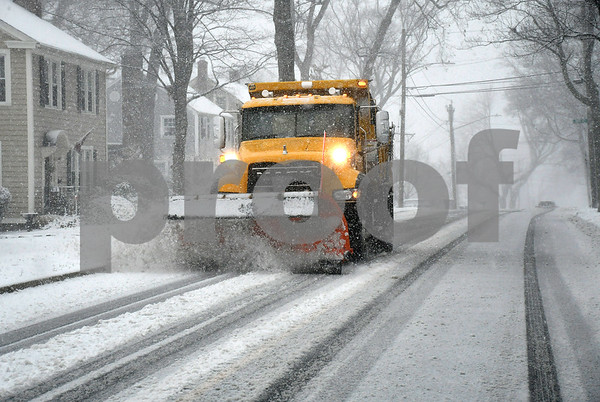 3/8/2018 Mike Orazzi | Staff A city snowplow on Oakland Street during Wednesday's storm in Bristol.
