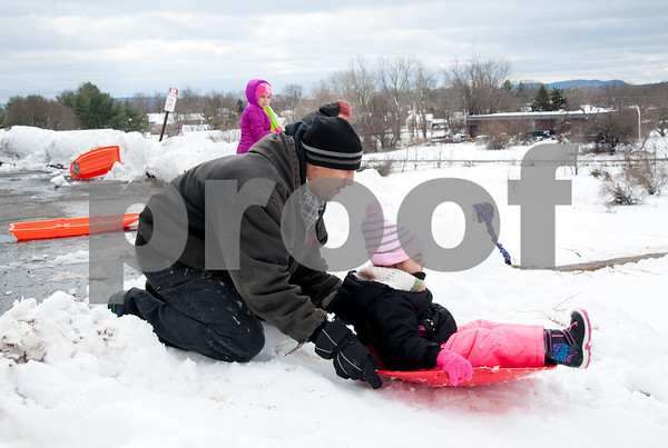 03/08/18 Wesley Bunnell | Staff Dayna Eatmon prepares to give push down the hill sledding to daughter Daynalis, age 3, at Smith Elementary School on Thursday following heavy snow through the city on Wednesday afternoon through the night.