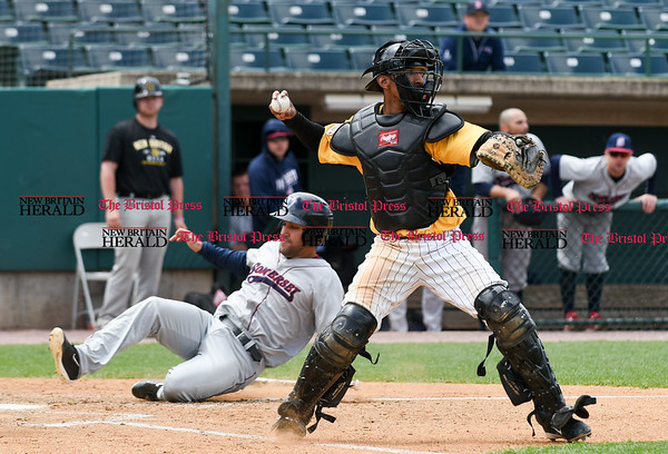 050317 Wesley Bunnell   Staff New Britain Bees vs Somerset Patriots in a Wednesday morning game attended by areas school children. James Skelton (3) receives the throw home and turns to throw to second base.