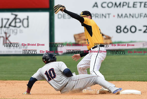050317 Wesley Bunnell | Staff New Britain Bees vs Somerset Patriots in a Wednesday morning game attended by areas school children. Jake McGuiggan (2) receives the throw from James Skelton (3) as the Somerset runner slides safely into second base.